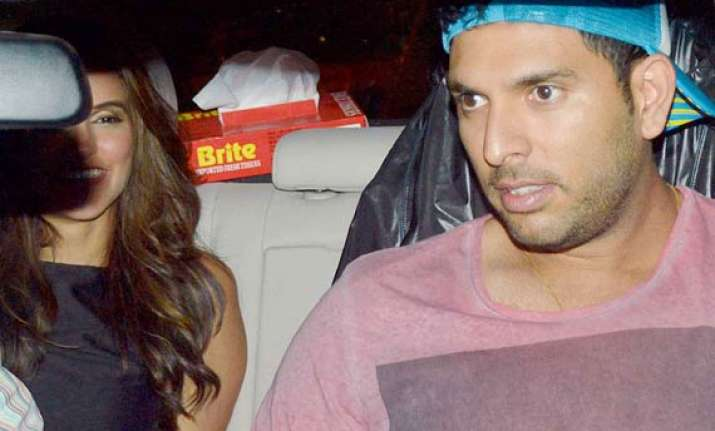 yuvraj singh neha dhupia spotted together is romance on