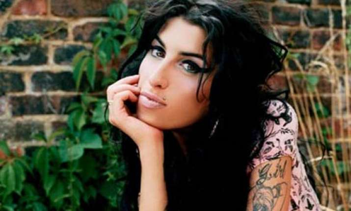amy winehouse cremated after memorial service