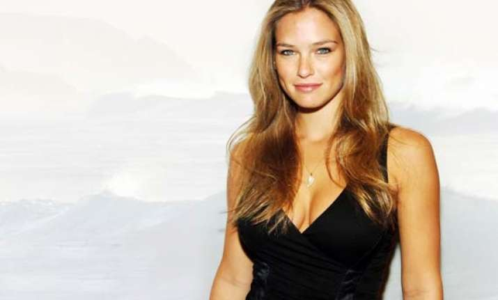 bar refaeli poses topless in war themed issue of magazine