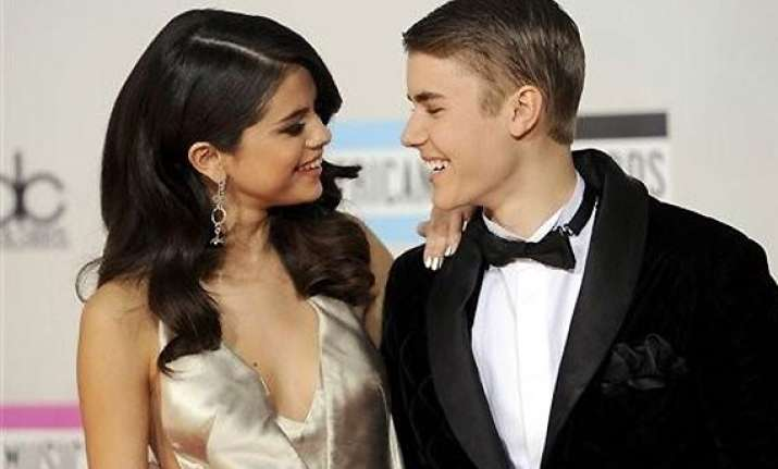 bieber s grand dad believes selena gomez is a positive
