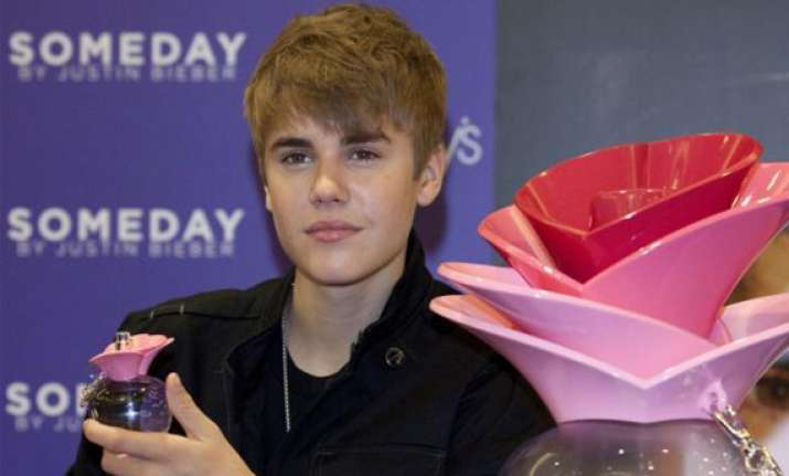 bieber tweets photo of to be launched fragrance