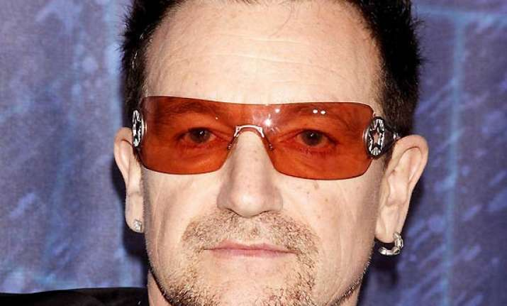 singer bono prays with family on bed