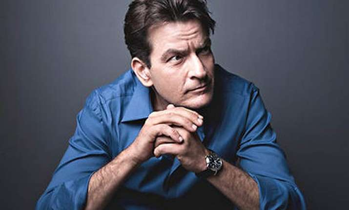 charlie sheen wants wife children to vacate his house