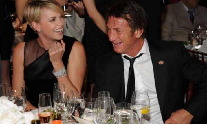 charlize theron sean penn to adopt a child