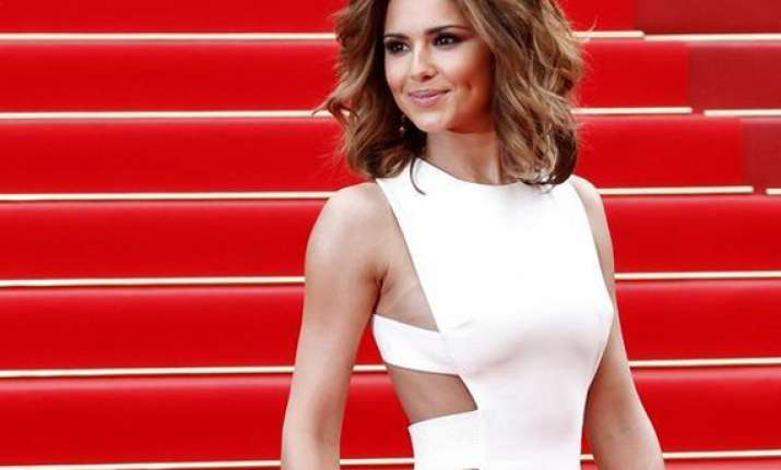 cheryl owes 70 000 pounds to bodyguard