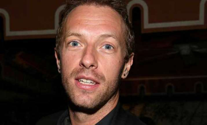 chris martin finds touring expensive