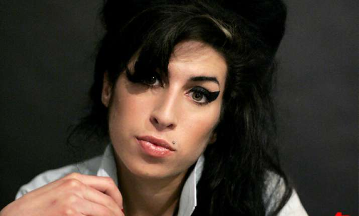 coroner says amy winehouse died from too much alcohol