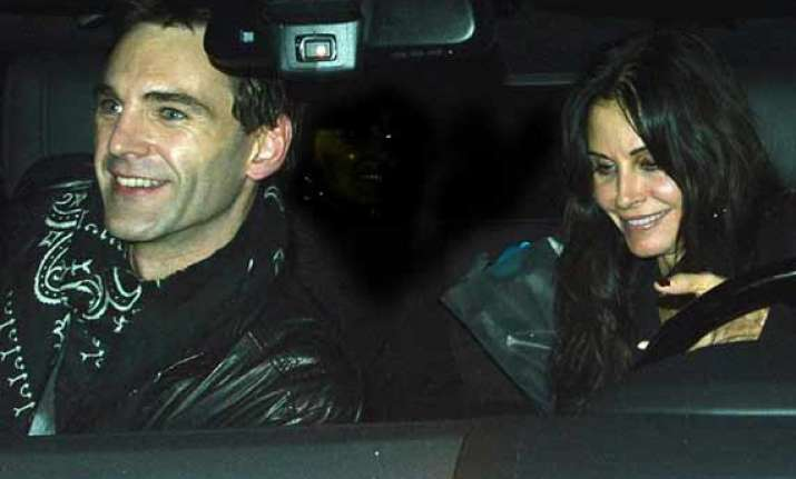courteney cox asks beau johnny mcdaid to move in