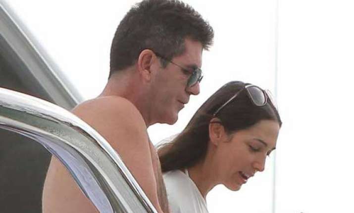 cowell gifts bangle to lauren
