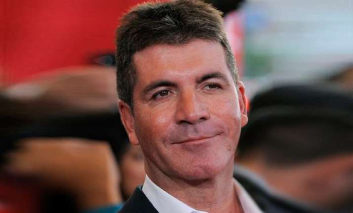 cowell talks voting by social media on x factor