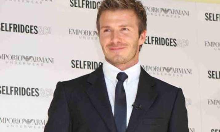 david beckham voted best celebrity in suit
