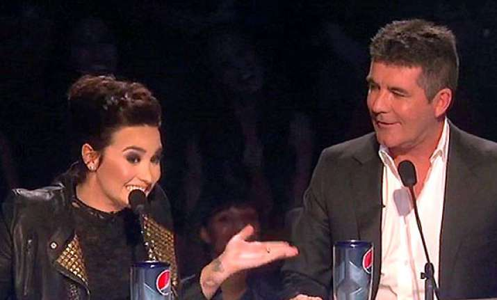 talent shows up in simon s absence demi lovato