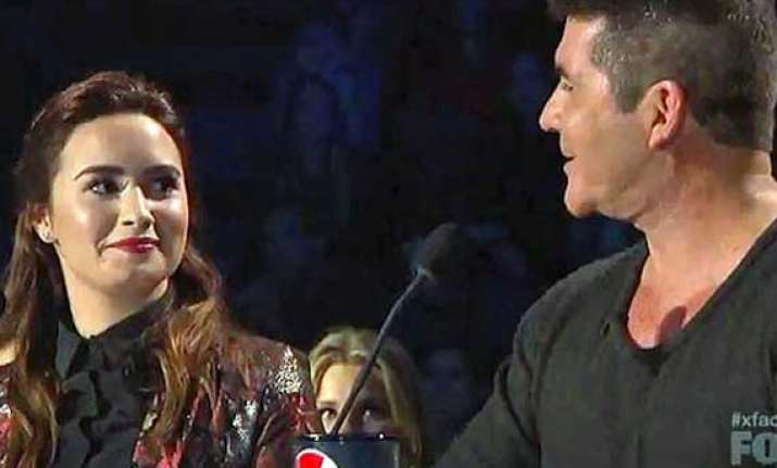 demi lovato not afraid of making simon cowell angry