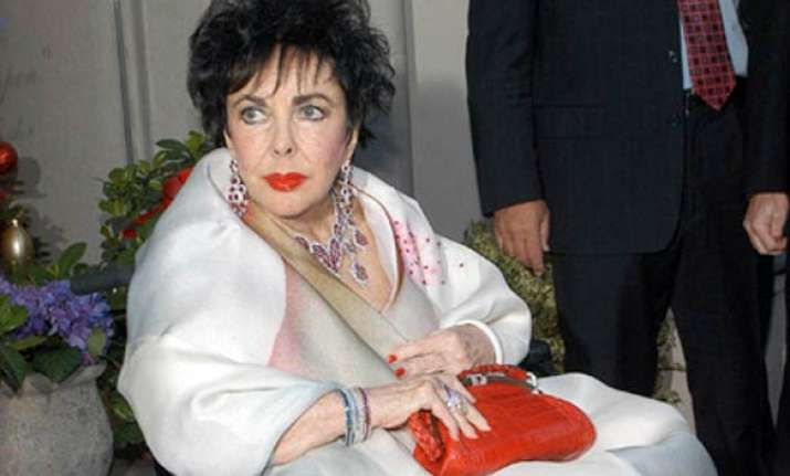 elizabeth taylor improves but remains in hospital