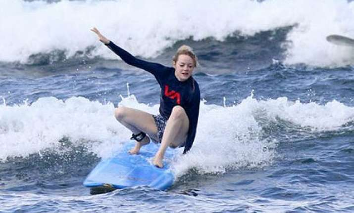 emma stone loves surfing see pics