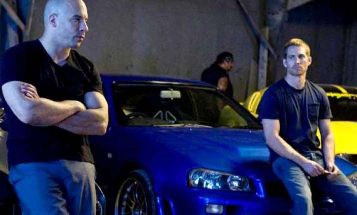 fast and furious 7 resumes production after paul walker s