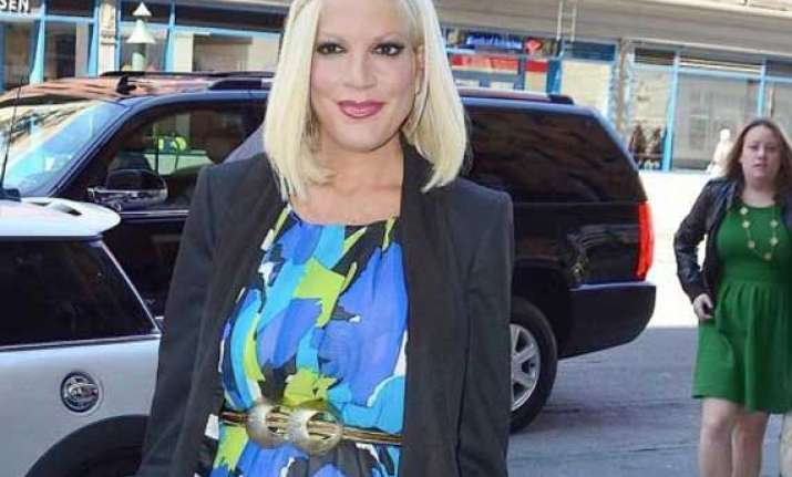 financially unstable tori spelling hasn t bought a purse in