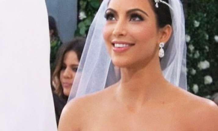 first look at beaming bride kim kardashian at wedding