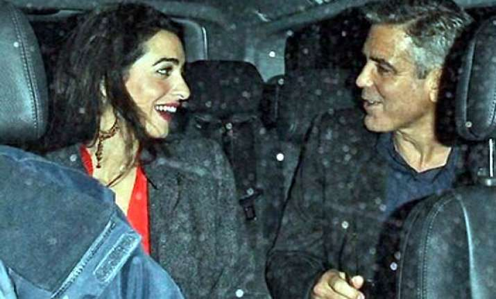 george clooney goes on a secretion vacation with girlfriend