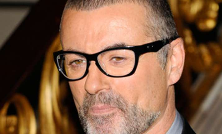 george michael treated for pneumonia cancels tour