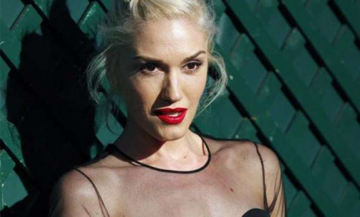 gwen stefani replacing christina aguilera in the voice next