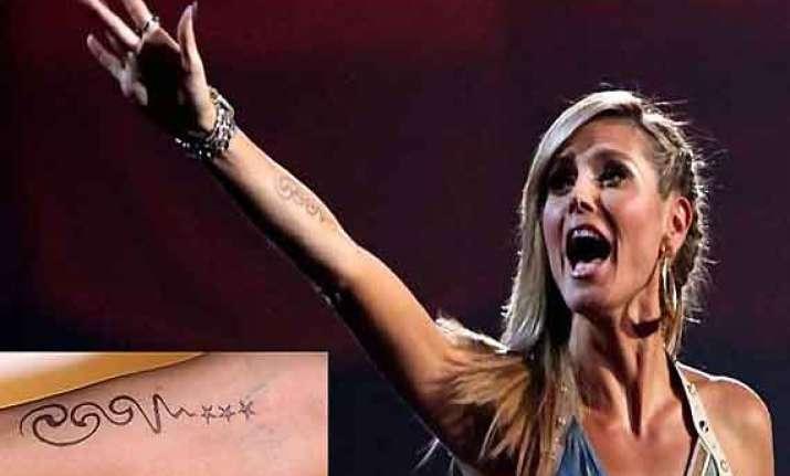 heidi klum to remove seal tattoo