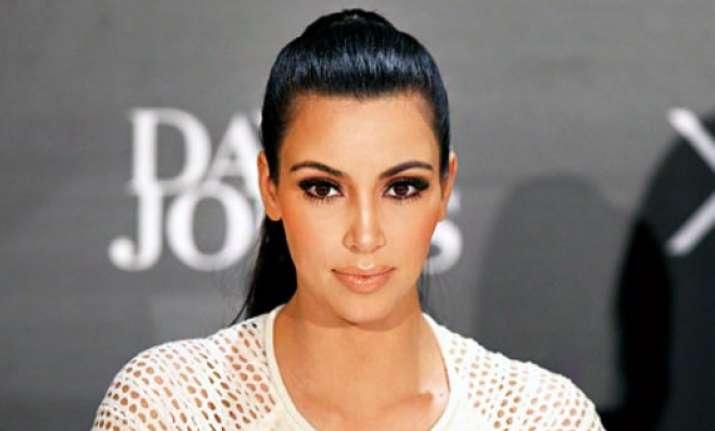 kim kardashian denies pregnancy reports