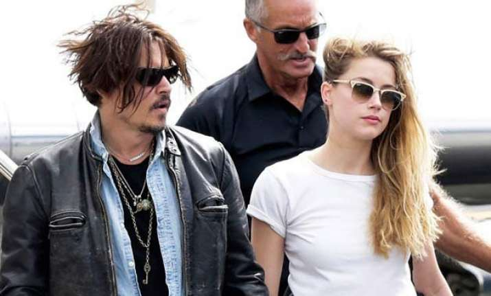 johnny depp s wife amber heard charged with smuggling dogs