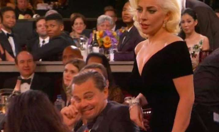 golden globes dicaprio s weird eye rollout at lady gaga