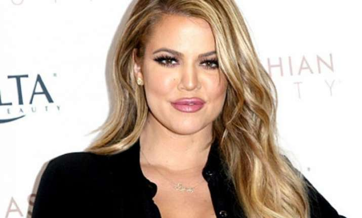 kim kardashian s sister khloe goes naked for cover of her