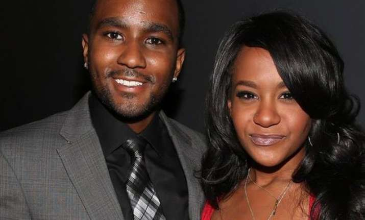 why is nick gordon trying to delay lawsuit in bobbi