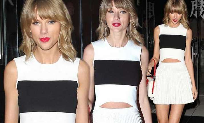 swift flaunts legs in tiny white skirt