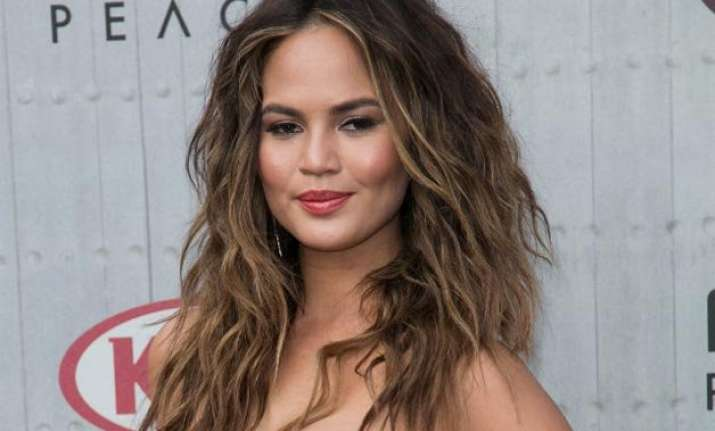 chrissy teigen poses nude for photoshoot