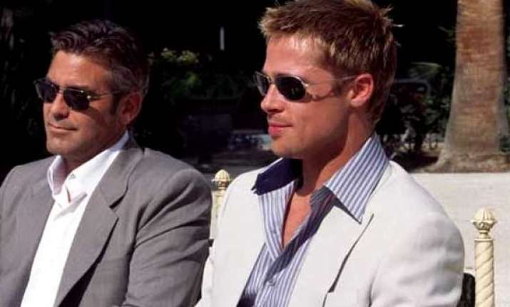 brad pitt george clooney raise a toast for their nuptials