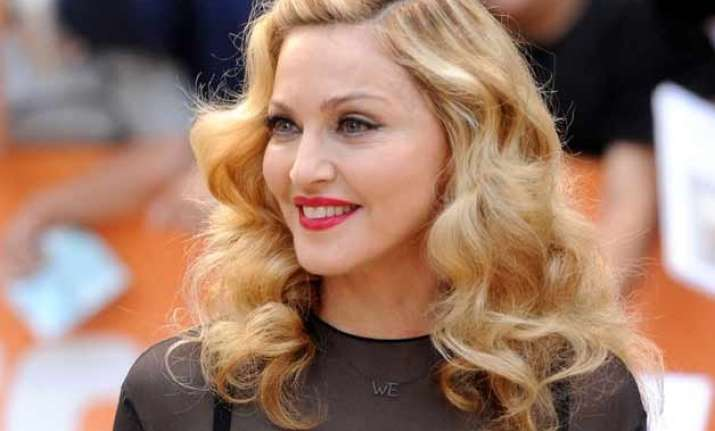 madonna likely to miss her own post oscars party