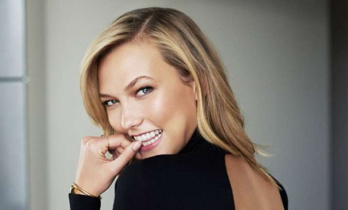 karlie kloss feels responsibility as a role model