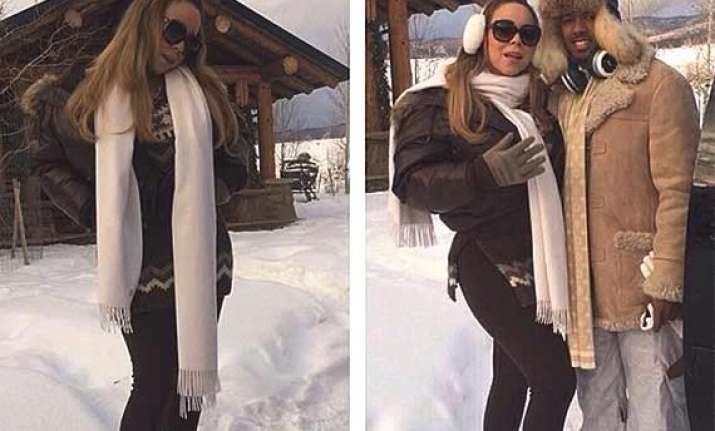 mariah carey cuddles up to cannon lookalike