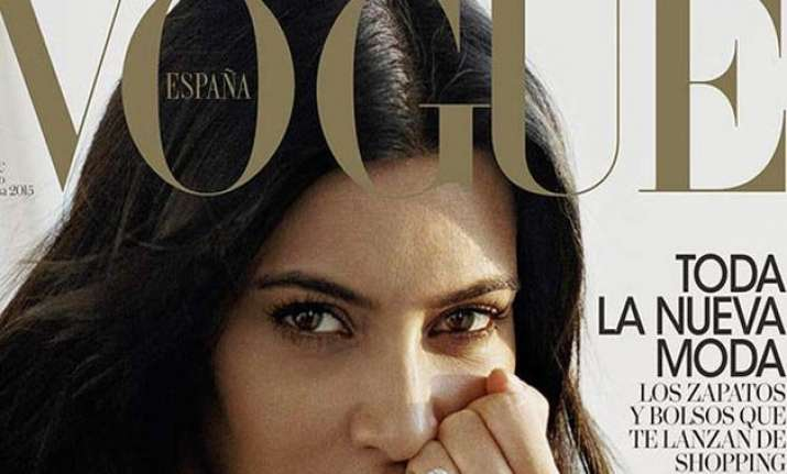 kim kardashian poses for a magazine cover without make up