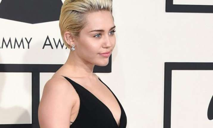 miley cyrus poses topless with pet cat
