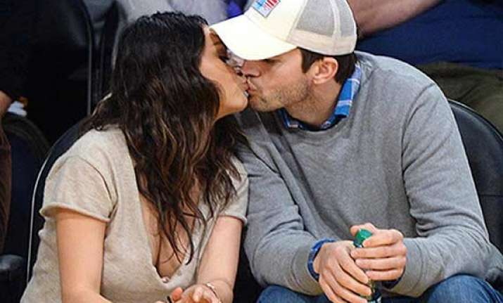 ashton kutcher mila kunis gets cosy during basketball match