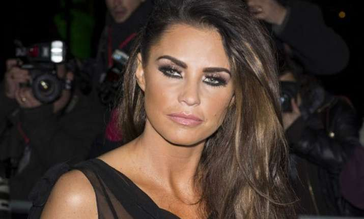 katie price plans to sell old breast implants for charity