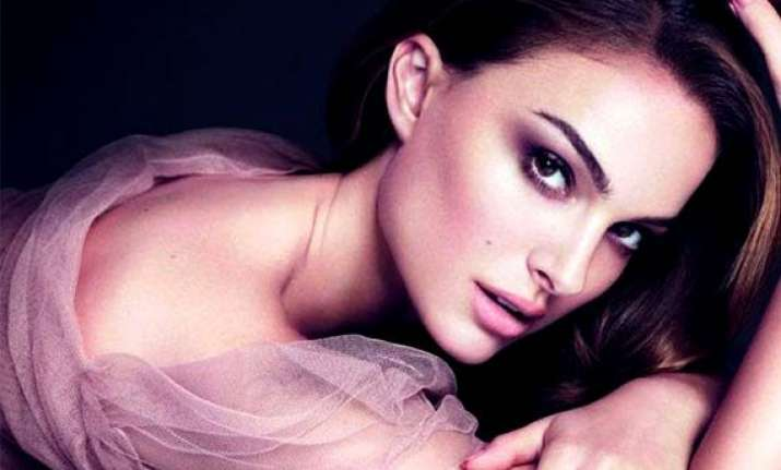 natalie portman honoured to be face of dior
