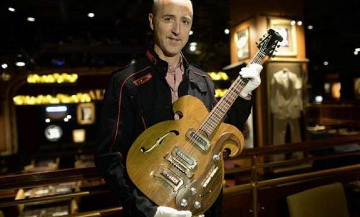 john lennon s guitar to be auctioned