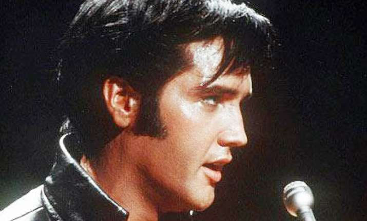 elvis presley s hair auctioned for 18 300