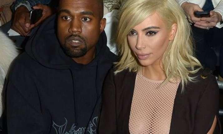 kim kardashian steals attention with mesh dress