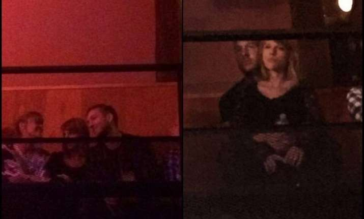 taylor swift beau calvin harris spotted in romantic embrace
