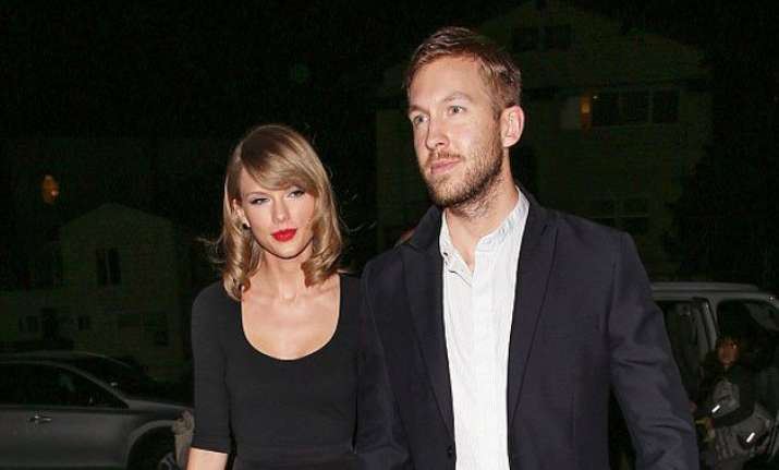 calvin harris rubbishes rumours about break up with taylor