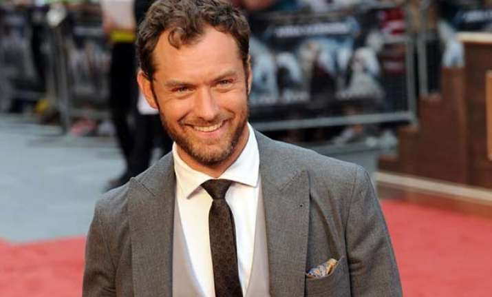 jude law satisfied how his children s life turning out