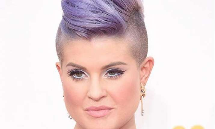 kelly osbourne to dip wisdom teeth in gold