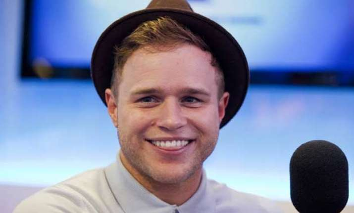 olly murs hopes time heals feud with brother